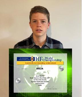 Java Miller holding an HF World Championship certificate.